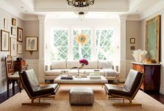 Love the eclectic mix of antiques and modern. Love those retro leather chairs!