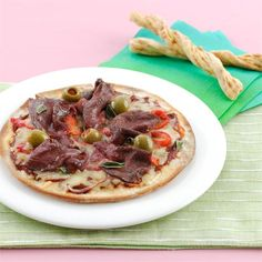 Thinly sliced beef works perfectly on a pizza. Once you have mastered this simple recipe try experimenting with additional flavours and toppings.