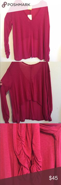 "💞Free People Lo-Hi Knit Top💕 I absolutely love this light, airy sweater, with its long ruched sleeves and beautiful berry color (Dahlia)! I just didn't realize how high the back was when I got it and I do not have a posture or backside flattering to this style. My (huge) loss, your gain!! Measuresments: Bust 22"" armpit-to-armpit, Front length is 26"" taken from back middle collar, the sides are slightly longer and shoulders are slightly higher (30"" at longest). Back length (also from back…"