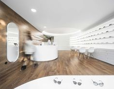 Image 31 of 34 from gallery of Optical Pitães / Tsou Arquitectos. Photograph by Ivo Tavares Studio Cool Store, Interior Lighting, Store Design, Space, Architecture, Gallery, Photograph, Retail, Studio