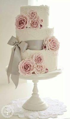 white wedding cake, gray/pink color scheme