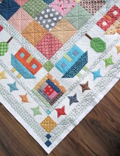 Quilty Fun with Lori Holt of Bee in My Bonnet...multiple borders include stars houses with trees with log cabin in the corner.... xxx