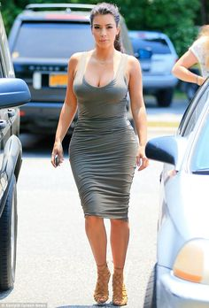 Not leaving much to the imagination: Kim Kardashian stepped out in The Hamptons on Wednesd...