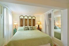 Key West Wabi Sabi | Key West Rentals - This bedroom adjoins the great-room and is staged with a craftsman built wooden king size platform bed with a hand painted headboard.