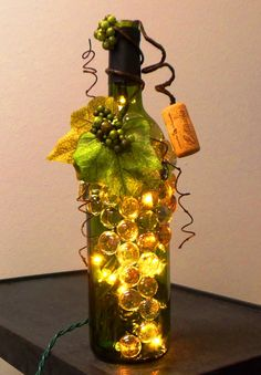 Like unusual and unique lighting? Need a great accent light for your kitchen or mantle? This dark reen wine bottle light is embellished with beautiful