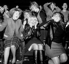 Screaming women fans of the pop group The Beatles at one of their concerts in Manchester. - Press Association