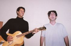 A young John Oliver singing as Richard Ayoade accompanies on guitar. British Humor, British Comedy, British Men, Richard Ayoade, John Oliver, Shitty Friends, Young John, Are You Not Entertained, The Daily Show