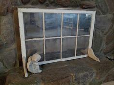 Fireplace screen from recycled old window and Krylon Looking Glass spray paint