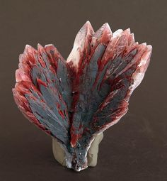 Calcite with inclusions from Leiping, Leyang, Hunan, China. A really very unusual spray of crystals of Calcite that have good brilliance and are partially colored by red oxides.