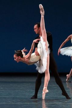 "Maria Kowroski and Tyler Angle in the second movement of ""Symphony in C."" Credit Andrea Mohin/The New York Times"