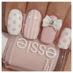 I love the color pink and the design of these nails. I wouldn't wear the bow though - too big.