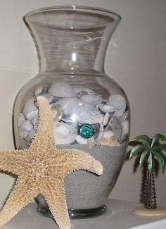 Pretty sand and shell decor ideas, this is perfect for remembering special beach memories.