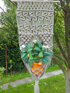 Macrame wall hanging is made in Germany with a natural linen (flax) rope and beech stick. Macrame width without stick is 34 cm, Macrame length without rope for hanging is 104 cm. The pictured pot has a diameter about 16 cm. It would be super gift or wall decor for your home. If you