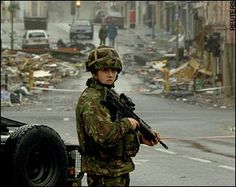 A soldier guards the scene of the bombing in Omagh's shopping area: Ulster Troubles 'could be redefined as a war'