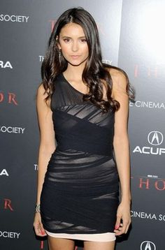 Nina dobrev in a stunning black dress.