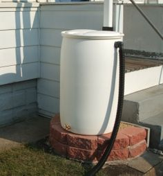 How to install a rain barrel, and additional steps to create an attractive stand out of cinder blocks