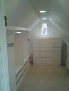 Angled ceilings in Old Seattle homes, No problem. We have solutions for that. #walkincloset