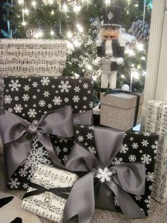 Lovely Christmas gift wrap looks—not traditional colors, but they work—black • white • silver❣ jaimee rose