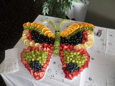 This Fresh Fruit Butterfly Pizza takes the cake for creativity and it's a healthy alternative. Decorate with all your favourite seasonal fruits, your guests will love it!