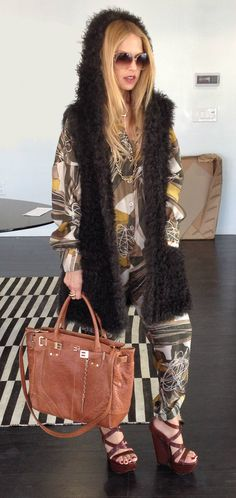 Loving this hooded fur vest! http://rosendorfevansfurs.com/