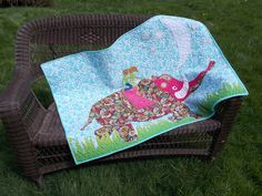 Baby Quilts and Diaper bags - Sharon Sinclair Kids riding an elephant quilt made two sided with cotton.