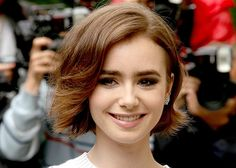 There's a reason why we've never seen Lily Collins experience a bad hair day: Her cut works with any hair type and face shape—plus, even though it's short, she can still tuck it behind her ears.
