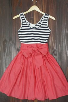 Darling navy and white stripes adorns the jersey upper half. Adorable sweet flowy red cotton skirt. ootd nautical dress red white and blue 4th of july american made threads