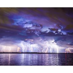 Lightning strikes more than once in this dazzling mural. A storm above water is captured in an array of blues and purples. Lightning Strikes Wall Mural comes on 6 panels and measures 8 ft. x 9 ft. 8 in. when assembled. Eye Of The Storm, Lightning Strikes, Lightning Storms, Purple Walls, City Scene, Of Wallpaper, Planets Wallpaper, Go Camping, Ocean Waves