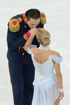 Team Figure Skating: Pairs - OLY-2014-FSKATE-SHORT-PAIRS-TEAM Russia's Maxim Trankov kisses the hand of his partner Russia's Tatiana Volosozhar after performing the Figure Skating Pairs Team Short Program at the Iceberg Skating Palace during the Sochi Winter Olympics on February 6, 2014. AFP PHOTO / YURI KADOBNOV (Photo credit should read YURI KADOBNOV/AFP/Getty Images)