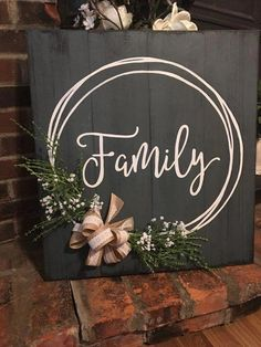 Family hand painted sign with hand drawn wreath burlap and lace bow foliage babys breath. Distressed weathered great gift Family hand painted sign with hand drawn wreath burlap and lace bow foliage babys breath.