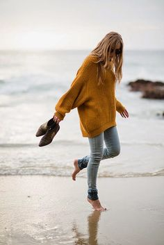 Yellow oversized sweater, tight jeans, shoes. Beach. Fall summer fashion, Women clothing
