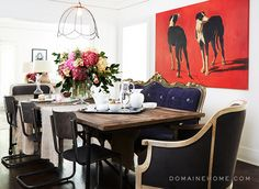Lea Michele's mixed seating arrangement of industrial dining room chairs & a one-of-a-kind French Baroque-inspire blue velvet settee gives her space homey-ness.