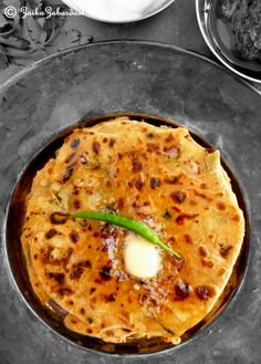 Paratha aka whole wheat Indian flat bread is eaten traditionally for breakfast all over the northern India. Simple paratha is normally made of whole wheat flour but when you stuff it with any filli…