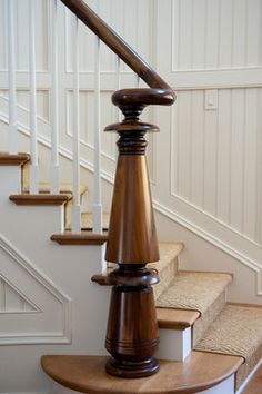 Turned Walnut Newel Post on Bead Board Paneled Stair Architectural Detail Foyer Staircase American Architectural Details TraditionalNeoclassical by Island Architects Foyer Staircase, Entry Stairs, House Stairs, Spiral Staircase, Traditional Staircase, Traditional House, Railing Design, Staircase Design, Railing Ideas
