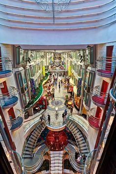 Liven up your nights onboard Voyager of the Seas. The Royal Promenade features parades, dancing, restaurants and duty-free shopping.