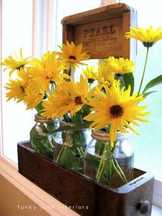 flowers in mason jars in an old sewing machine drawer! love it!