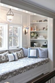 cozy window seat with shelving.