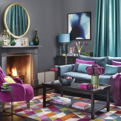 How to decorate your home with jewel tones Feeling bold with your colour choices? Be inspired to fill your home with an abundance of jewel coloured soft furnishings, furniture and accessories. Good Living Room Colors, Bold Living Room, Colourful Living Room, Living Room Color Schemes, Beautiful Living Rooms, Living Room Paint, Living Room Designs, Jewel Tone Living Room Decor, Jewel Tone Room