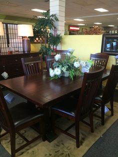 Stunning, solid wood, trestle table.  New to the floor and only $2533 for the 9 PIECE SET!!!!
