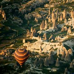 Hot air balloon in Cappadocia, Turkey. How cool are those rock formations? Super cool.