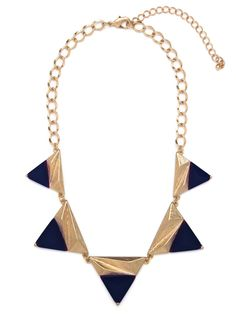 This stunning statement style is cool as ice. It features graphic triangular pendants, each crafted from a mix of coolly faceted gold and deep indigo-colored gems.