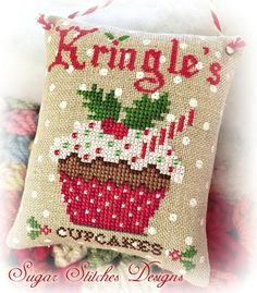 Kringles Cupcakes Cross Stitch Chart Model stitched on 32 ct Petit Point Raw… Cross Stitch Christmas Ornaments, Xmas Cross Stitch, Cross Stitch Love, Christmas Cross, Cross Stitch Charts, Cross Stitch Designs, Cross Stitching, Cross Stitch Embroidery, Embroidery Patterns