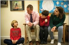 Headmaster Ben Powers talking with some students.