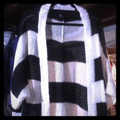 Black & White Open Cardigan Simply put...it's a black & white cardigan. Perfect to throw on with leggings, jeans or a dress! It's yours. torrid Sweaters Cardigans