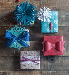 Pretty holiday gift wrapping by Lia Griffith. Made with the Cricut Explore and Pretty Packages Cricut image set