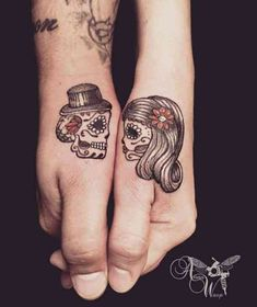 Loving his and hers sugar skull tattoos. Most BOO-tiful Halloween tattoos are he… Loving his and hers sugar skull tattoos. Most BOO-tiful Halloween tattoos are here to help you get ready for the most terrifying day of the year! Partner Tattoo Hand, Partner Tattoos, Skull Couple Tattoo, Couple Tattoos Love, Married Couple Tattoos, Neue Tattoos, Body Art Tattoos, Script Tattoos, Sleeve Tattoos