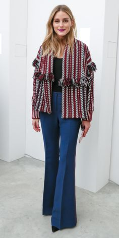 Olivia Palermo was unstoppable during her tour of the spring 2017 collections. Her latest look? A printed, striped cardigan-like jacket that brought street-style flari to her simple black top and navy wide-leg pants.
