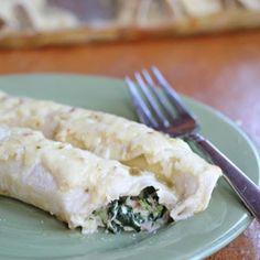 Chicken and Spinach Enchiladas - I think if I use Greek yogurt and reduced fat cheese and whole wheat tortillas this will be a great low calorie dish.  Hmmmm we will see.  I will let you know.