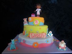 Such a cute Doc McStuffins cake.  All figures are made out of gumpaste, except the doll on top.  I combined my ideas with some pics from the internet.