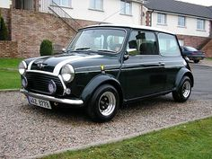 Classic Mini Cooper.  Maybe once all the kids are out of booster seats!  :)